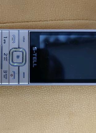 S -tell,мобильный телефон/кнопочный.