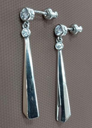 Серебряные женские серьги - гвоздики  и подвижной частью с золото