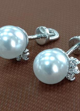 Серебряные женские серьги - гвоздики с жемчужиной и вставками...
