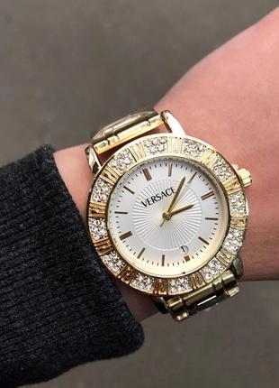 Женские часы золотые с белым циферблатом