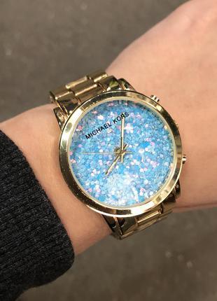 Женские часы золотые