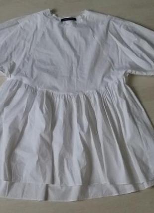 Біле стильне плаття з актуальним рукавом