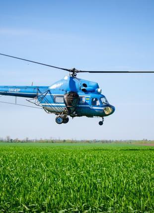 Обработка полей вертолетами Ми-2