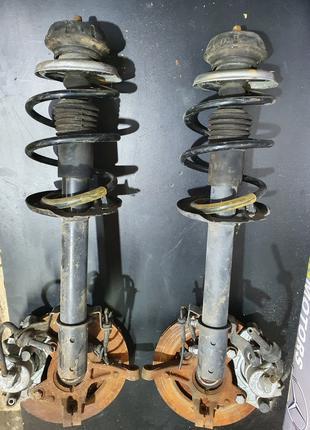 Передний амортизатор в сборе (цапфа, ступица, поворотный кулак...