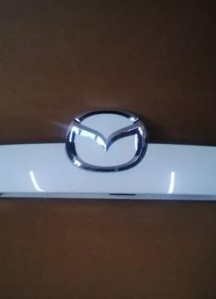 Mazda CX-7 Накладка двери багажника.