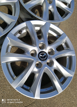 Диски литые оригинал Mazda R16(5*114,3)et50