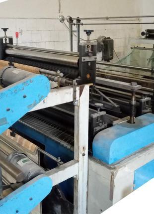 Двухручейный автомат по изготовлению пакетов в рулонах.