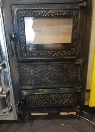 Печная чугунная спаренная дверца с жаропрочным стеклом.