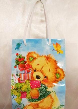 Пакет ламинированый подарочный  для упаковки детского подарка.