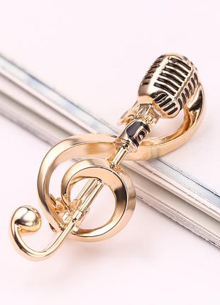 Брошь «Скрипичный ключ с микрофоном».