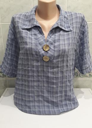 Блуза прямого кроя.