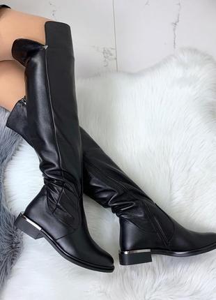Зимние ботинки из натуральной кожи на низком каблуке
