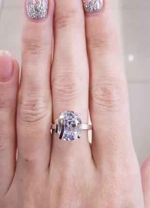 Серебряное кольцо с пластинами золота и фианитом
