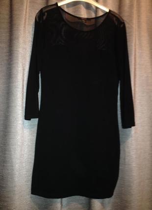 Оригинальное трикотажное платье.279