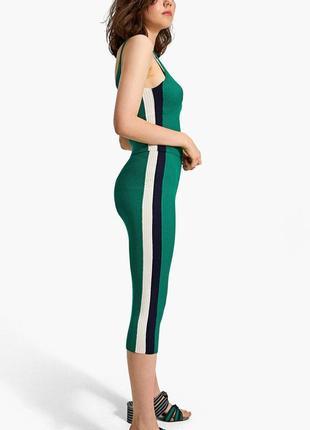 Трикотажная зеленая юбка миди чулок на высокой посадке в рубчи...