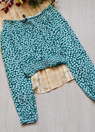 Блузка с открытыми плечами в цветочный принт с длинным рукавом...