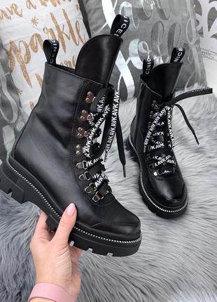 Зимние кожаные ботинки в спортивном стиле с оригинальными шнур...