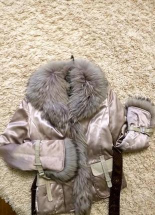 Курточка с мехом енота