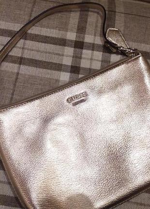Маленькая  золотая сумочка клатч от гуесс оригинал