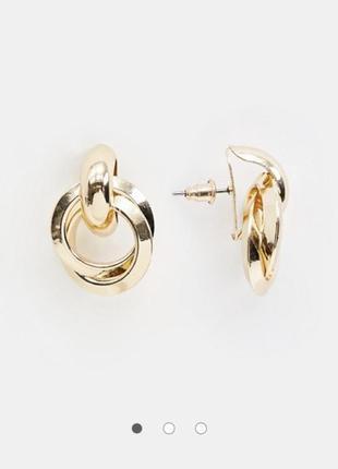 Золотистые серьги кольца гвоздики с двух колец