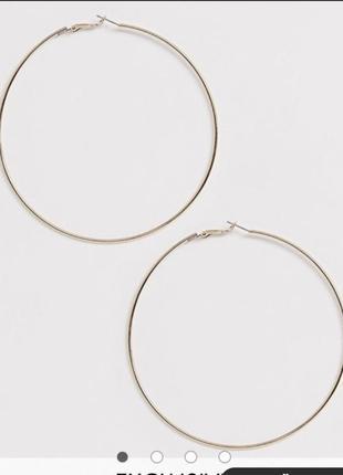 Большие золотистые серьги кольца