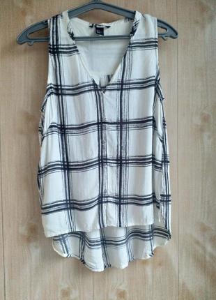 Стильная блузка с удлиненной спиной