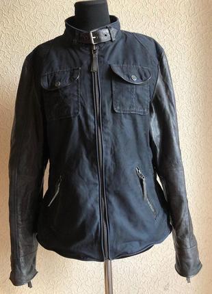 Темно-синяя куртка от бренда gipsy с кожаными рукавами