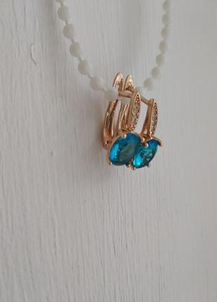 Серьги с голубым камнем