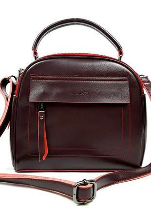 Женская кожаная сумка бочонок бордового цвета