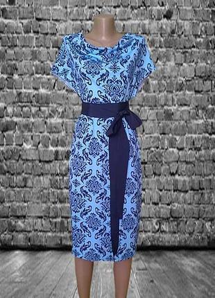 Трикотажное Платье футляр голубого цвета