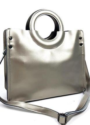Женская вместительная кожаная сумка цвета серебра