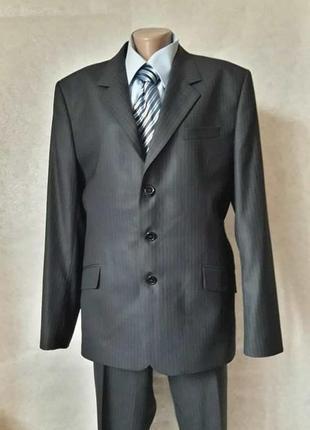 Новый классический качественный мужской костюм в тёмно синем ц...