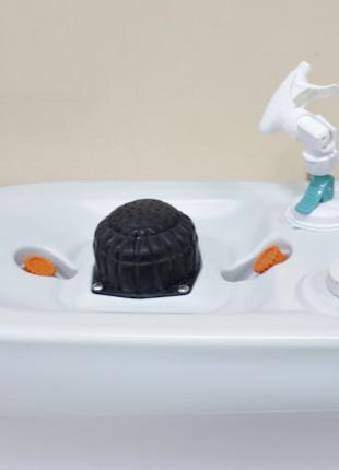 Портативний (пересувний) прилад для миття ніг або взуття.