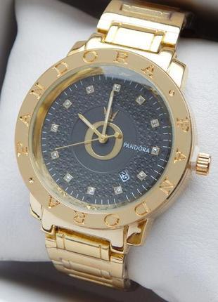 Женские кварцевые наручные часы золотого цвета с черным циферб...