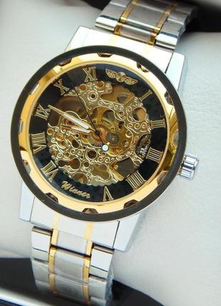Мужские механические наручные часы скелетоны winner серебро-зо...