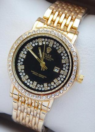 Женские наручные часы золотистые с черным циферблатом с больши...
