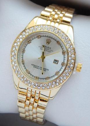 Женские наручные часы золотые с серебристым циферблатом, два р...