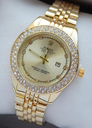 Женские наручные часы, золотые с двумя рядами страз, отображен...