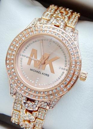 Очень красивые женские часы цвета розовое золото с большим кол...