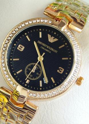 Красивые женские наручные часы золотые с черным циферблатом
