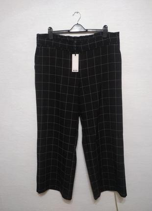 Стильные модные брюки в клетку большого размера