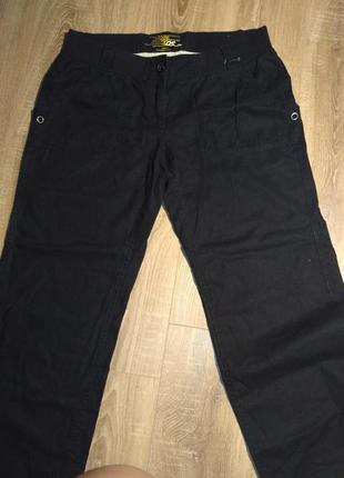 Классные фирменные брюки, черного цвета размер 42- 44