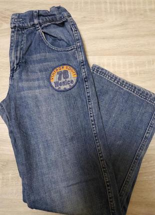 Стильные фирменные джинсы на мальчика рост 146