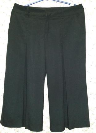 Фирменные  черные брюки-юбка zara,