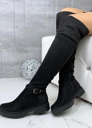 Зимние ботфорты на низком каблуке