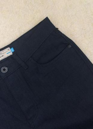 Темно-синие зауженные джинсы на болтах с пропиткой