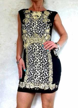 Аккуратное платье по фигуре с узорами