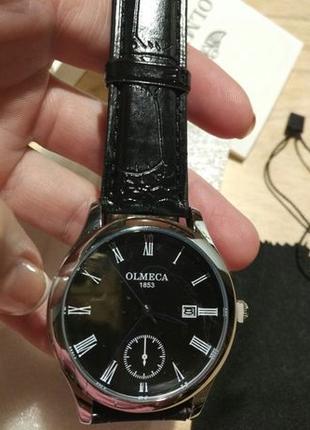 Наручные кварцевые часы Olmeca в упаковке.