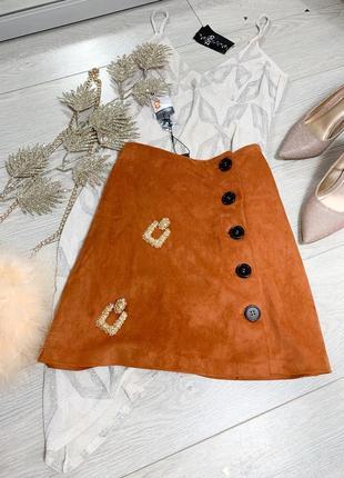 Рижа юбка на пуговицах
