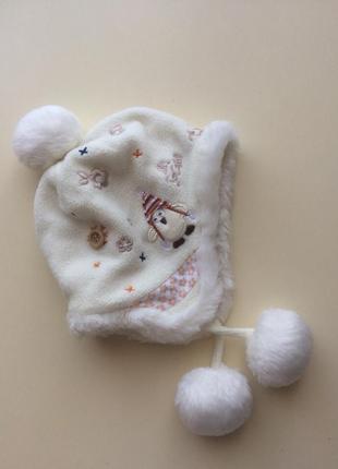 Флисовая шапочка c помпонами от next для девочки 3-6 мес.